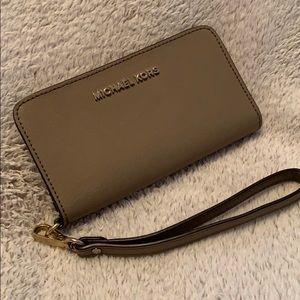 Tan Michael Kors wallet/ cellphone holder
